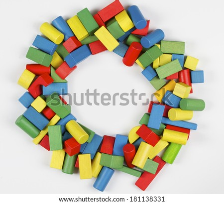 Toys blocks circle frame, multicolor wooden building bricks, group of colorful game pieces - stock photo