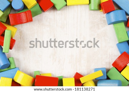 Toys blocks frame, multicolor wooden building bricks, group of colorful game pieces  - stock photo