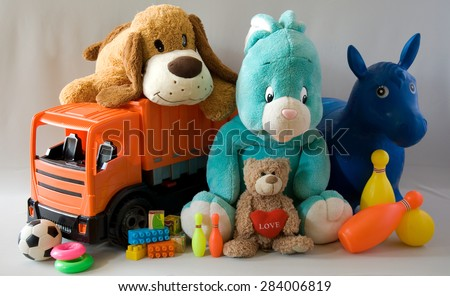 Toys - cheerful family - stock photo