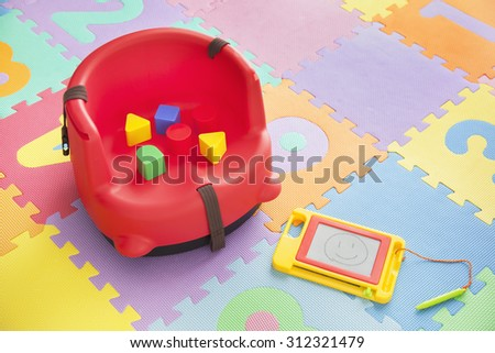 Toys for kids on play mat - stock photo