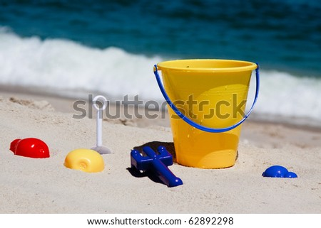 Toys on a beach - stock photo