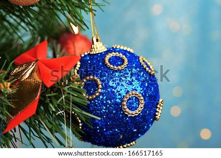 Toys on Christmas tree on  Christmas lights background - stock photo