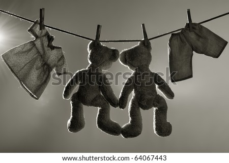 Toys on clothes line - stock photo