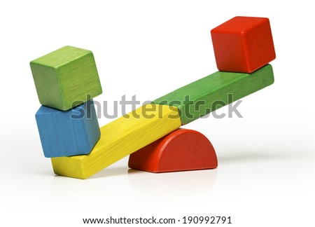 toys seesaw wooden blocks, teeter totter isolated on white background balance weight cube, swing  with heavy and light idea  - stock photo