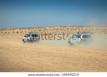 Tozeur,Tunisia-15,August,2013:Image of off road cars in the desert Sahara ,Tunisia - stock photo