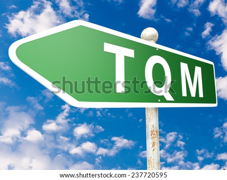 TQM - Total Quality Management - street sign illustration in front of blue sky with clouds.