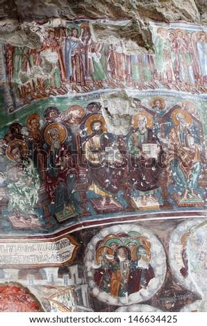 TRABZON, TURKEY-AUG 4:  Vandalized Greek Orthodox frescoes,  at Sumela Monastery, dating to the 4th century,  are currently undergoing restoration at Sumela near Trabzon, Turkey on August 4, 2011.   - stock photo