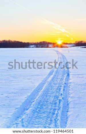 Trace of  a snowmobile - stock photo