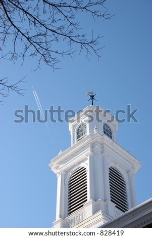 Trace of Airplane in the Sky over a Church