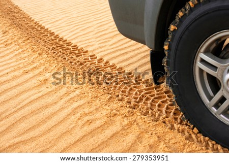 trace of rubber tires SUV in the desert sand. Riding a four-wheel drive vehicles passable attracts many tourists and professionals - stock photo