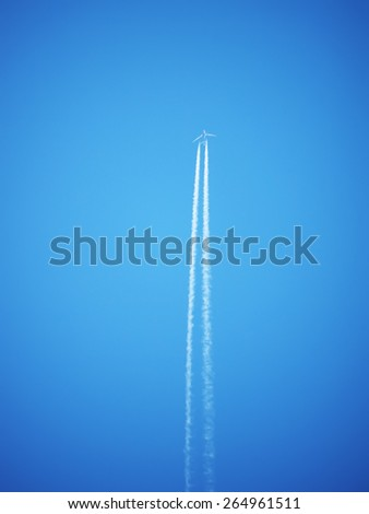 trace of the plane in the sky - stock photo
