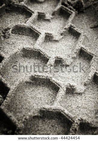 trace of tyre in the sand - stock photo