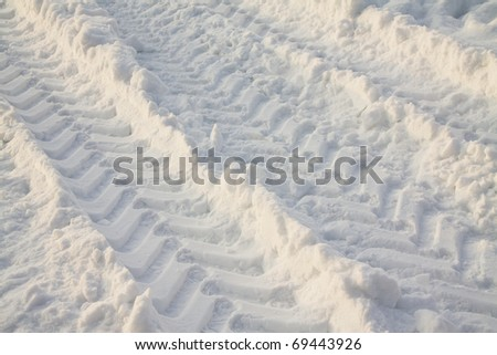Traces from wheels of the big car on snow (crude road) - stock photo