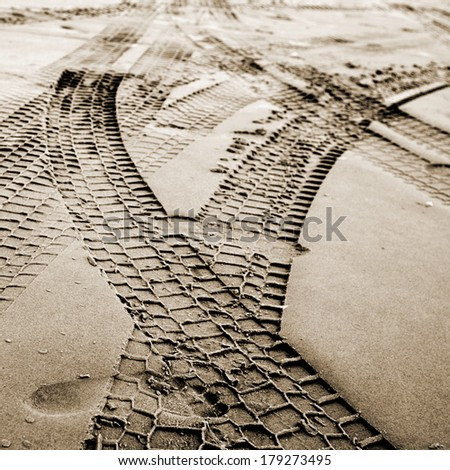 Traces in the sand - stock photo