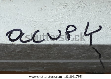 Traces of Occupy Remain. Occupy, as in Occupy Wall Street, written in marker on painted bulkhead by Union Square MTA entrance.