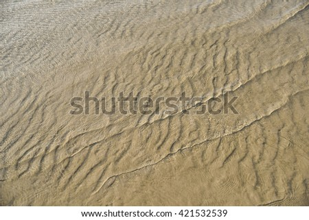 Traces of sand caused by the wave, Background. - stock photo