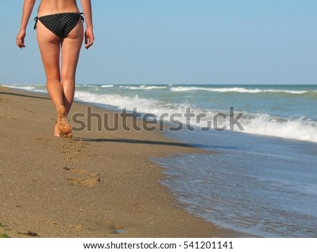 Traces of the girls on the beach stretching into the distance