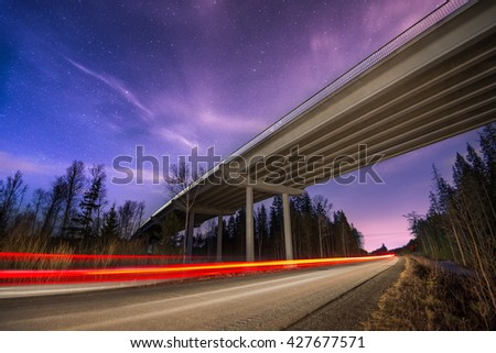 traces of the headlights on the road in the night - stock photo