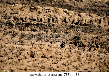 traces of the wheel off-road in mud - stock photo