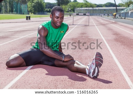 Track and Field Athlete Stretching - stock photo