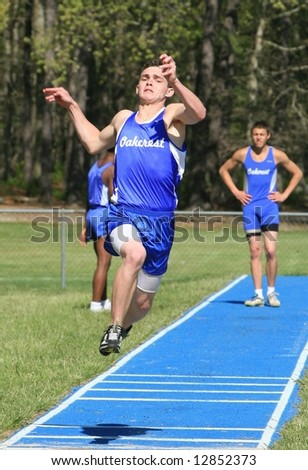 track and field jumping competition - stock photo