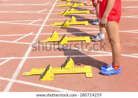 Track and field waiting for starting close-up