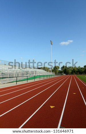 Track Field on a sunny day and blue sky on a vertical format - stock photo