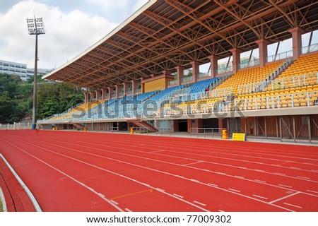 Track Lanes and Stadium - stock photo