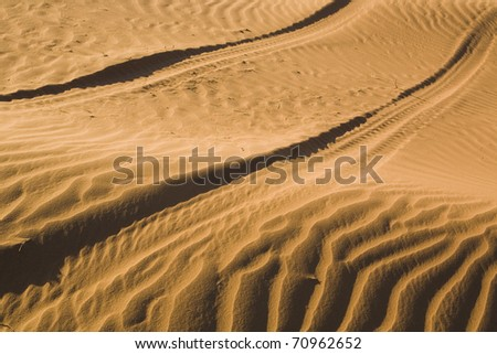 track of a car in the dessert of Namibia - stock photo