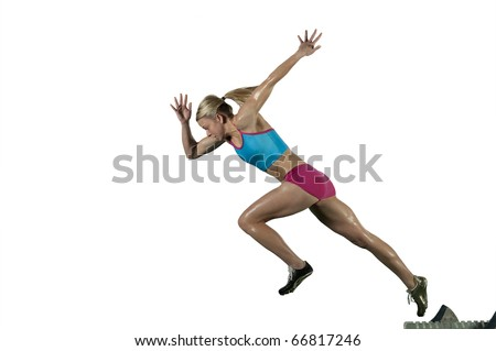 Track runner bursts off starting block against a white background - stock photo