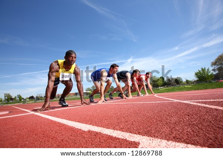 Track runners in starting position - stock photo