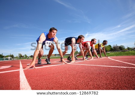 Track runners lined up for race - stock photo