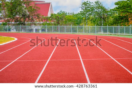 track running, red treadmill for athletics and competition. - stock photo