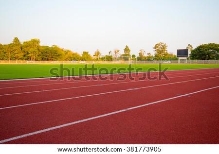 track running, Red treadmill in sport field. soft focus - stock photo