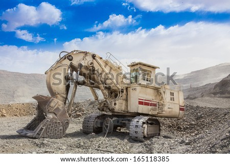 track-type loader excavator machine  at the opencast mining  - stock photo