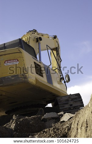 trackhoe as viewed from below in the trench - stock photo