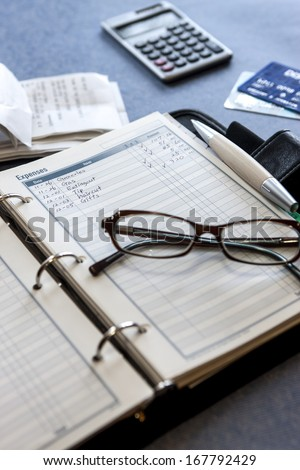 Tracking expenses. - stock photo