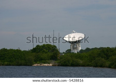 Tracking Satellite Dish against mottled sky with Everglades in foreground PHOTO ID: KSCRadar00016_RJ - stock photo