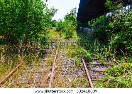 tracks at an abandoned train station - stock photo