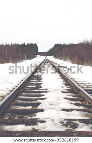 Tracks far away. Image of an empty railroad track going to far away. Image taken from a low point of view. Image has a vintage effect applied.