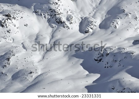 tracks from ski mountaineers in fresh snow. Climbing on the left and descending on the right - stock photo