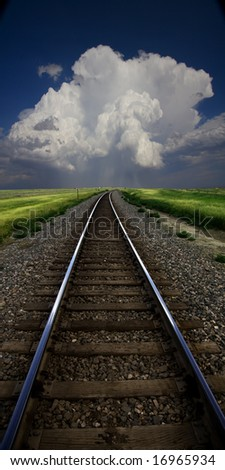 Tracks lead to storm cloud - stock photo