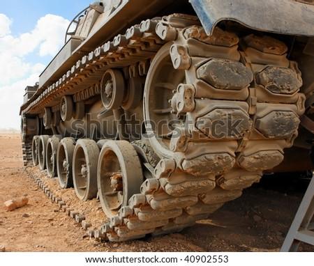 Tracks of the Israeli Magach tank in the desert closeup - stock photo