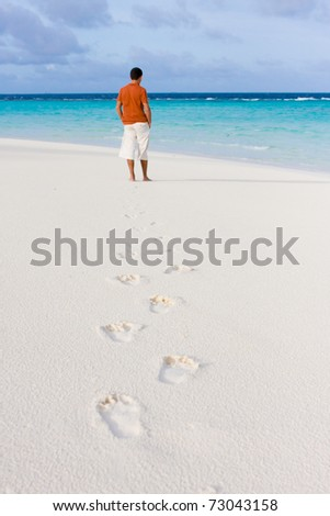 Tracks on sand of wonderful tropical beach