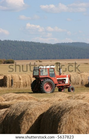 Tractor and Hay Harvest - stock photo