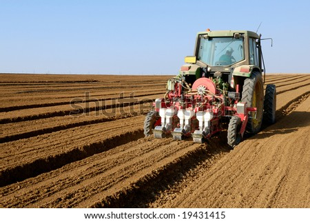 tractor at field - stock photo