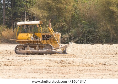 Tractor at the construction site. - stock photo