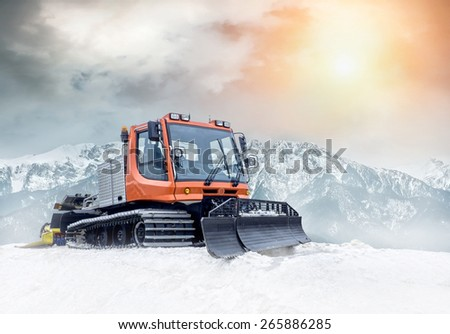 Tractor cleaning snow outdoors