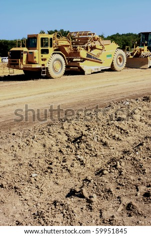 tractor clearing pathway for roads - stock photo