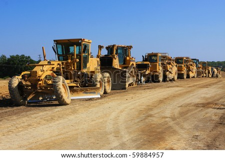 tractor convoy on a construction site - stock photo